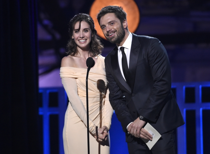 Alison Brie, left, and Sebastian Stan present the award for best action movie at the 23rd annual Critics' Choice Awards at the Barker Hangar on Thursday, Jan. 11, 2018, in Santa Monica, Calif. (Photo by Chris Pizzello/Invision/AP)