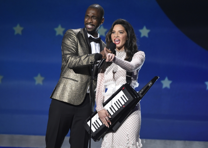 Jay Pharoah, left, and Host Olivia Munn speak at the 23rd annual Critics' Choice Awards at the Barker Hangar on Thursday, Jan. 11, 2018, in Santa Monica, Calif. (Photo by Chris Pizzello/Invision/AP)