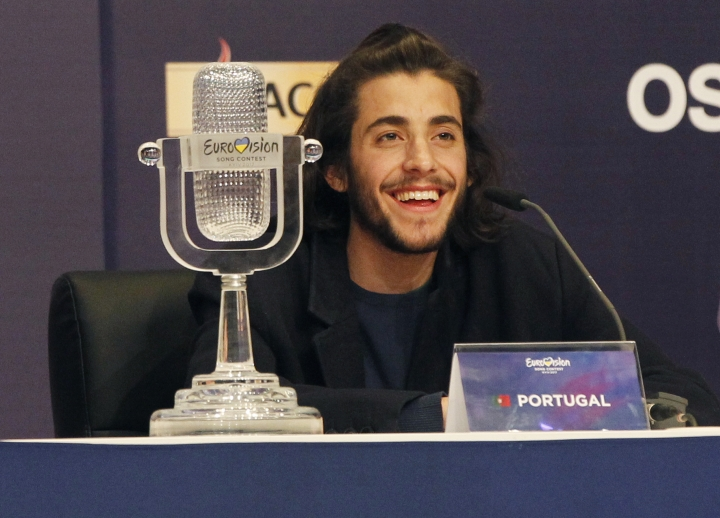 "FILE - In this Saturday, May 13, 2017 file photo, Salvador Sobral from Portugal smiles as he speaks after winning the Final of the Eurovision Song Contest with his song ""Amar pelos dois"" during a press conference in Kiev, Ukraine. Salvador Sobral has left a Portuguese hospital after a successful heart transplant he underwent in December 2017. (AP Photo/Sergei Chuzavkov, File)"
