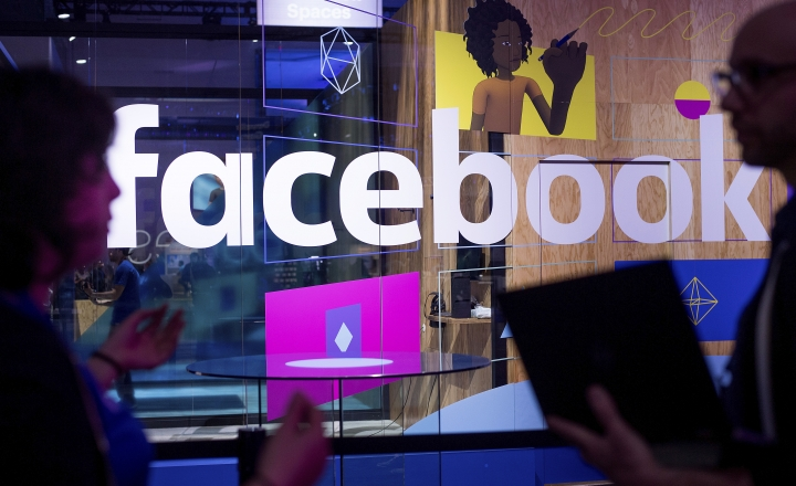 "FILE - In this April 18, 2017, file photo, conference workers speak in front of a demo booth at Facebook's annual F8 developer conference in San Jose, Calif. Facebook said Thursday, Jan. 11, 2018, that it is tweaking what people see to make their time on it more ""meaningful."" The changes come as Facebook faces criticism that social media can make people feel depressed and isolated. (AP Photo/Noah Berger, File)"