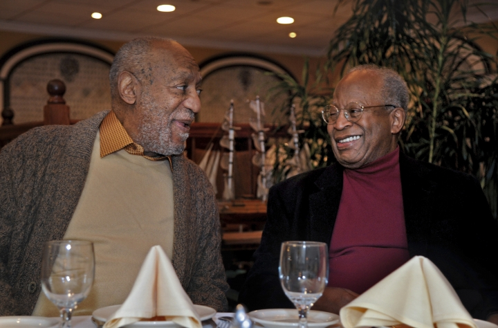 In this Wednesday, Jan. 10, 2018 photo, Bill Bill Cosby, left, has dinner with childhood friend Ed Ford at an Italian restaurant in Philadelphia. Cosby's new trial on charges he drugged and molested a woman in 2004 was supposed to begin in November, but was delayed until this spring so his new legal team could get up to speed. Jurors deadlocked in June and the judge declared a mistrial. He has said the encounter was consensual. (Tim Gralish/The Philadelphia Inquirer via AP)