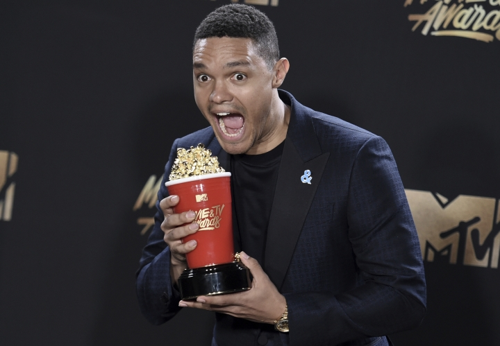 "FILE -- In this May 7, 2017 file photo, South African Comedian Trevor Noah poses with the award for best host for ""The Daily Show"" in the press room at the MTV Movie and TV Awards at the Shrine Auditorium in Los Angeles. Using vulgar language, U.S. President Donald Trump on Thursday, Jan. 11, 2018, questioned why the U.S. would accept more immigrants from Haiti and ""shithole countries"" in Africa rather than places like Norway in rejecting a bipartisan immigration deal. (Richard Shotwell/Invision/AP, File)"