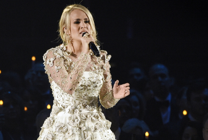 "FILE - In this Wednesday, Nov. 8, 2017, file photo, Carrie Underwood performs ""Softly and Tenderly"" during an In Memoriam tribute at the 51st annual CMA Awards at the Bridgestone Arena in Nashville, Tenn. Underwood teamed up with Ludacris to co-write a new song ""The Champion,"" which will be the opening video for the Super Bowl on Feb. 4 airing on NBC. The song, which was also written by country songwriters Brett James and Chris DeStefano, was released Friday, Jan. 12, 2018. (Photo by Chris Pizzello/Invision/AP, File"