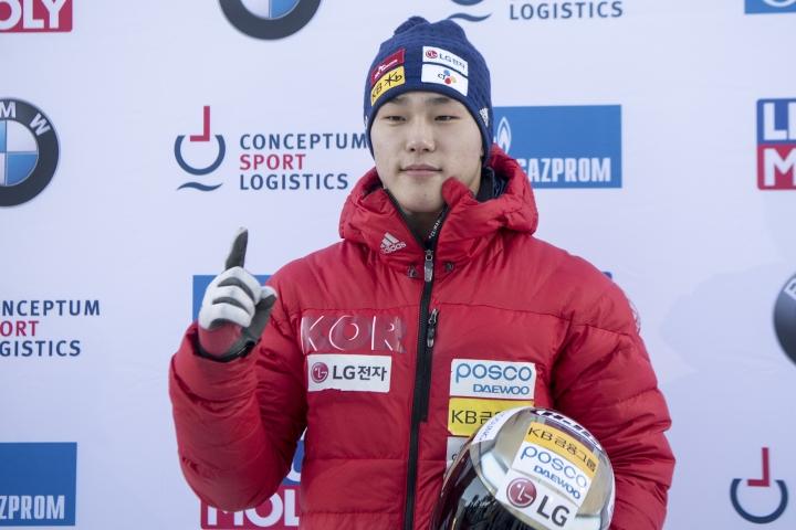 Yun Sungbin from South Korea celebrates his victory during the Men's Skeleton World Cup in St. Moritz, Switzerland, on Friday Jan. 12, 2018. (Urs Flueeler/Keystone via AP)