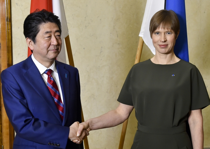 Japanese Prime Minister Shinzo Abe, left, and Estonian President Kersti Kaljulaid shake hands prior to their talks in Tallinn, Estonia, Friday, Jan. 12, 2018. Abe is on a visit to three Baltic countries, Estonia, Latvia and Lithuania. (AP Photo/Marko Mumm)