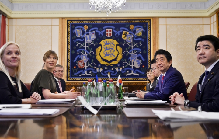 Japanese Prime Minister Shinzo Abe, second right, and Estonian President Kersti Kaljulaid, second left, pose for the media prior to their talks in Tallinn, Estonia, Friday, Jan. 12, 2018. Abe is on a visit to three Baltic countries, Estonia, Latvia and Lithuania. (AP Photo/Marko Mumm)