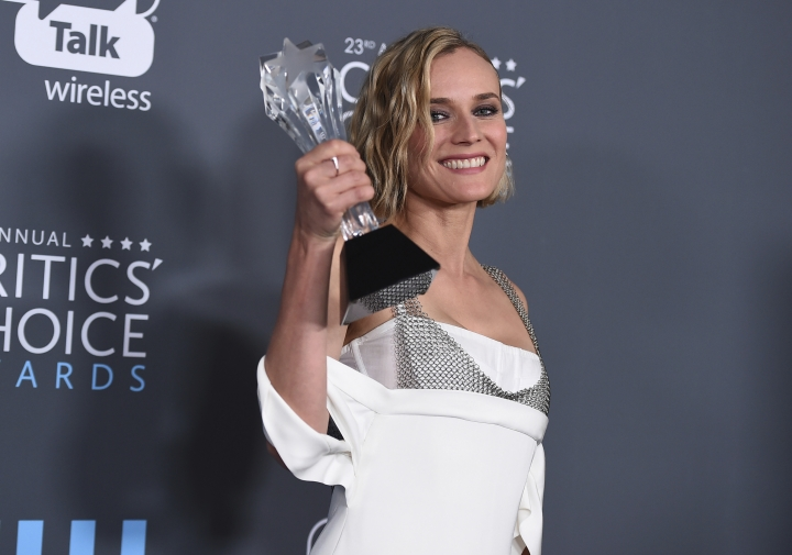"""Diane Kruger, winner of the award for best foreign language film for """"In The Fade"""", poses in the press room at the 23rd annual Critics' Choice Awards at the Barker Hangar on Thursday, Jan. 11, 2018, in Santa Monica, Calif. (Photo by Jordan Strauss/Invision/AP)"""