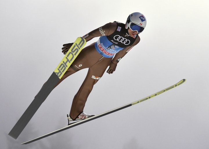 FILE - In this Jan. 5, 2018, file photo, Poland's KamilStoch makes his trial jump at the ski jump in Bischofshofen, Austria, the fourth stage of the Four Hills Ski Jumping event. With an historic win on the World Cup circuit, double Olympic champion Kamil Stoch is in peak form as he aims to defend his ski jumping titles at the Pyeongchang Games. (AP Photo/Kerstin Joensson, File)