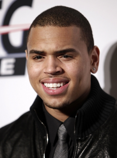 FILE - In this Feb. 7, 2009 file photo, Chris Brown arrives at the Clive Davis pre-Grammy party in Beverly Hills, Calif. California fish and wildlife agents have seized Brown's pet monkey from his Los Angeles home. Capt. Patrick Foy says Friday, Jan. 12, 2018, that investigators determined the singer didn't have a permit for the capuchin monkey, named Fiji. (AP Photo/Matt Sayles, file)