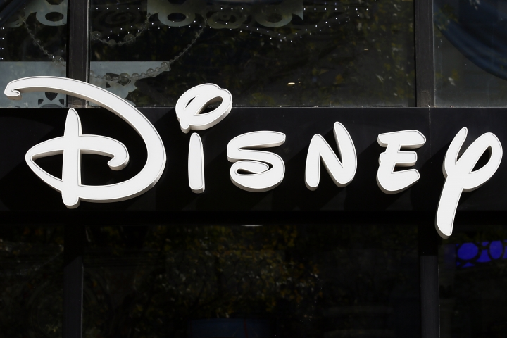 "This photo taken Sept. 20, 2017, shows the logo of theme parks ""Disney"" Store on the Champs Elysees Avenue in Paris, France. Facebook COO Sheryl Sandberg and Twitter CEO Jack Dorsey won't stand for re-election to the board of The Walt Disney Co. A Disney spokesperson says it has become ""increasingly difficult for them to avoid conflicts relating to board matters."" With Disney planning to put ESPN online and Twitter live-streaming sports like NFL football, online video is surely an area of overlap. (AP Photo/Francois Mori)"