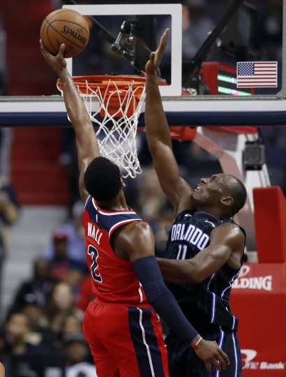Washington Wizards guard John Wall (2) shoots over Orlando Magic center Bismack Biyombo (11) during the first half of an NBA basketball game Friday, Jan. 12, 2018, in Washington. (AP Photo/Alex Brandon)