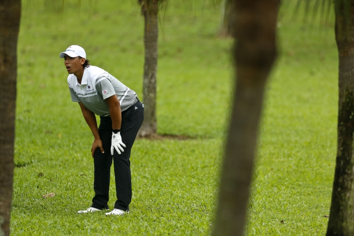 Gavin Green of Malaysia reacts on the 9th hole during the foursome matches of the 2018 EurAsia Cup golf tournament at Glenmarie Golf & Country Club in Shah Alam, Malaysia, Saturday, Jan. 13, 2018. (AP Photo/Sadiq Asyraf)