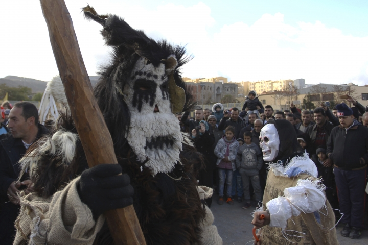 Disguised men perform in the village of Beni Snous, south of Tlemcen, Algeria, Thursday, Dec.11, 2018. Algerians in the Beni Snous region dress in elaborate animal-hide costumes and parade through town with traditional instruments as part of the Ayred festival. (AP Photo/Anis Belghoul)