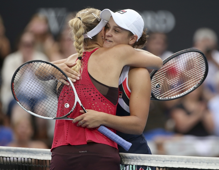 Angelique Kerber of Germany, left, hugs Ash Barty of Australia at the end of their women's final singles match at the Sydney International tennis tournament in Sydney, Saturday, Jan. 13, 2018. Kerber won the match. (AP Photo/Rick Rycroft)