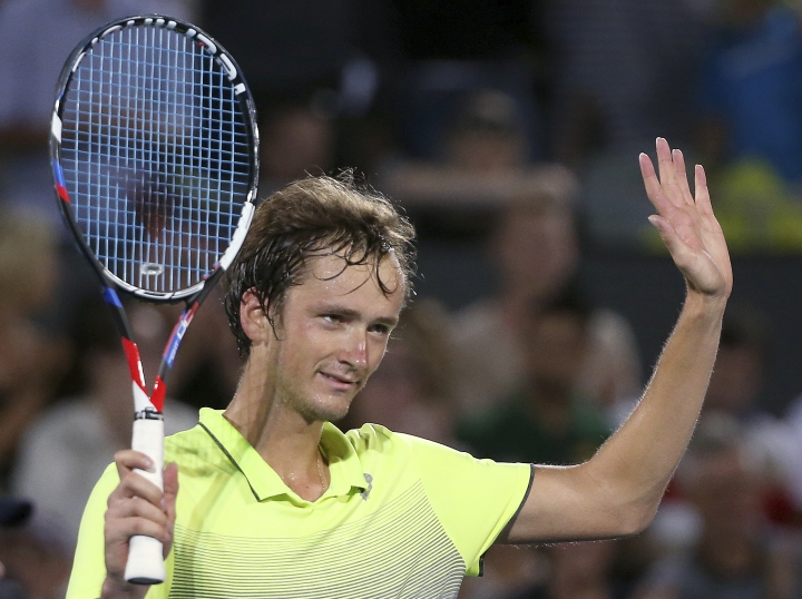 Daniil Medvedev of Russia celebrates his win over Alex De Minaur of Australia in their men's final singles match at the Sydney International tennis tournament in Sydney, Saturday, Jan. 13, 2018. (AP Photo/Rick Rycroft)