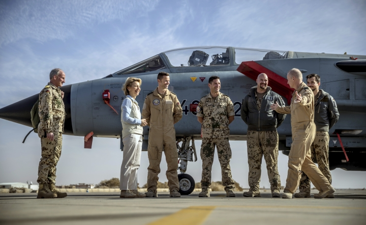 German defense minister Ursula von der Leyen, second left, speaks with soldiers after her arrival to Azraq air base in northern Jordan Saturday, Jan. 13, 2018. The Germany's defense minister is visiting a Jordanian air base where German troops have been stationed since October as part of an international military campaign against Islamic State extremists. A group of German parliamentarians accompanied Ursula von der Leyen on Saturday during her tour of the Azraq base in northern Jordan. (Michael Kappeler/Pool via AP)