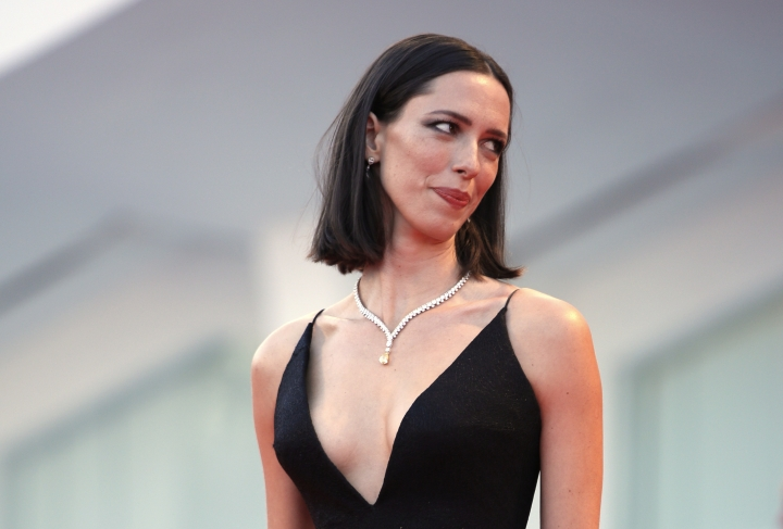 "FILE - In this Sept. 5, 2017 file photo, actress Rebecca Hall poses for photographers at the premiere of the film 'mother!' at the 74th edition of the Venice Film Festival in Venice, Italy, Hall says she's donating her salary from the latest Woody Allen film to Time's Up. Hall said on Instagram she was hired for Allen's ""A Rainy Day in New York"" but is ""profoundly sorry"" and ""regrets"" her decision to work with the filmmaker. She said Friday, Jan. 12, 2018, she reconsidered the job after reviewing molestation accusations by Allen's daughter Dylan Farrow. (AP Photo/Domenico Stinellis, File)"