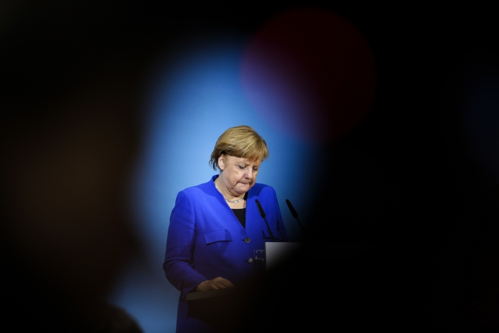 German Chancellor Angela Merkel attends a joint statement after the exploratory talks between Merkel's conservative bloc and the Social Democrats on forming a new German government in Berlin, Germany, Friday, Jan. 12, 2018. (AP Photo/Markus Schreiber)