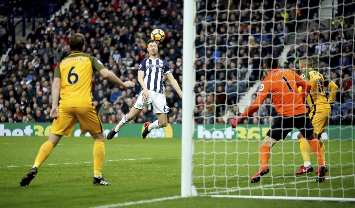 West Bromwich Albion's Jonny Evans scores his side's first goal of the game against Brighton & Hove Albion during the English Premier League soccer match at The Hawthorns, West Bromwich, England, Saturday Jan. 13, 2018. (Nick Potts/PA via AP)