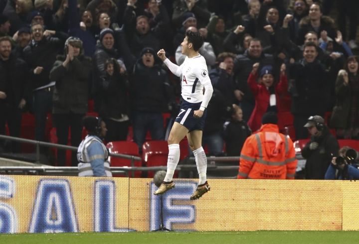 Tottenham Hotspur's Son Heung-Min celebrates scoring his side's first goal of the game during the English Premier League soccer match at Wembley Stadium, London, Saturday Jan. 13, 2018. (John Walton/PA via AP)