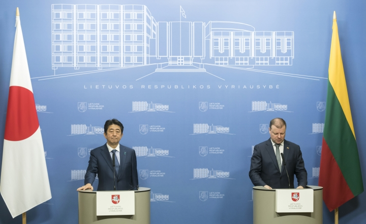 Japanese Prime Minister Shinzo Abe listens during the meeting with Lithuania's Prime Minister Saulius Skvernelis at the government's headquarters in Vilnius, Lithuania, Saturday, Jan. 13, 2018. (AP Photo/Liusjenas Kulbis)