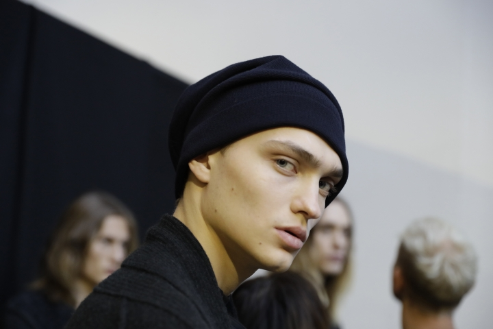 A model waits backstage prior to the Isabel Benenato men's Fall-Winter 2018-19 collection, that was presented in Milan, Italy, Saturday, Jan.13, 2018. (AP Photo/Luca Bruno)