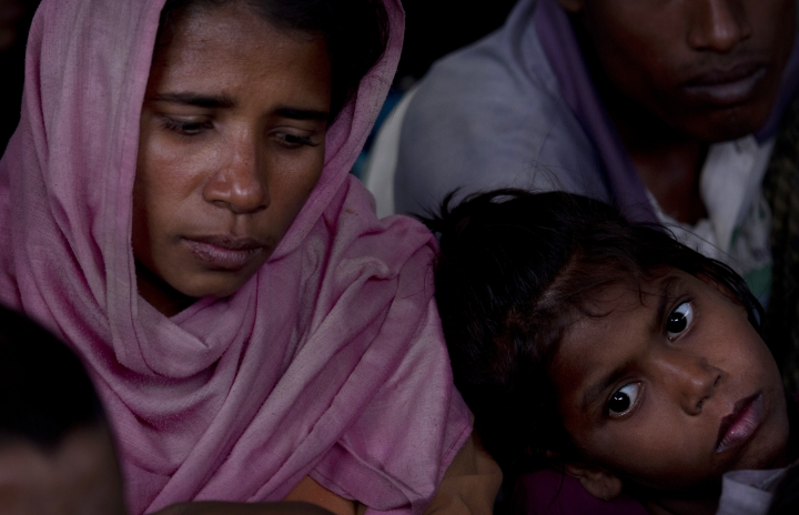 """A newly arrived Rohingya family waits at a temporary shelter before their registration at Nayapara refugee camp, some 69 kilometres (43 miles) from in Cox bazar, Bangladesh, Saturday, Jan. 13, 2018. In Rakhine state of Myanmar, government troops have been accused of """"ethnic cleansing"""" that has forced more than 655,000 of Rohingya Muslims to flee into Bangladesh, out of which 60 per cent of the refugees are children. (AP Photo/Manish Swarup)"""
