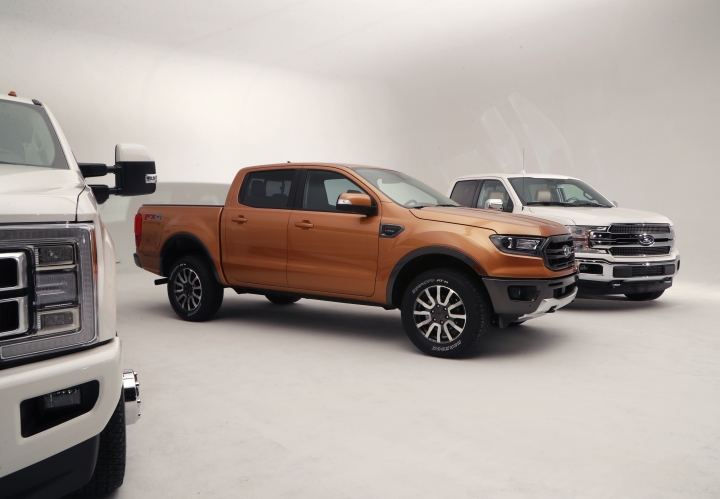 This Jan. 5, 2018, photo shows the 2019 Ford Ranger, center, next to the automaker's F-350, left, and the F-150 in Warren, Mich. Ford is unveiling the North American version of the Ranger on Sunday, Jan. 14, ahead of the Detroit auto show. It goes on sale next spring, eight years after Ford pulled it off the market in the U.S. and Canada. (AP Photo/Carlos Osorio)