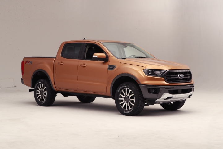 This Jan. 5, 2018, photo, shows the 2019 Ford Ranger truck on display in Warren, Mich. Ford is unveiling the North American version of the Ranger on Sunday, Jan. 14, ahead of the Detroit auto show. It goes on sale next spring, eight years after Ford pulled it off the market in the U.S. and Canada. (AP Photo/Carlos Osorio)