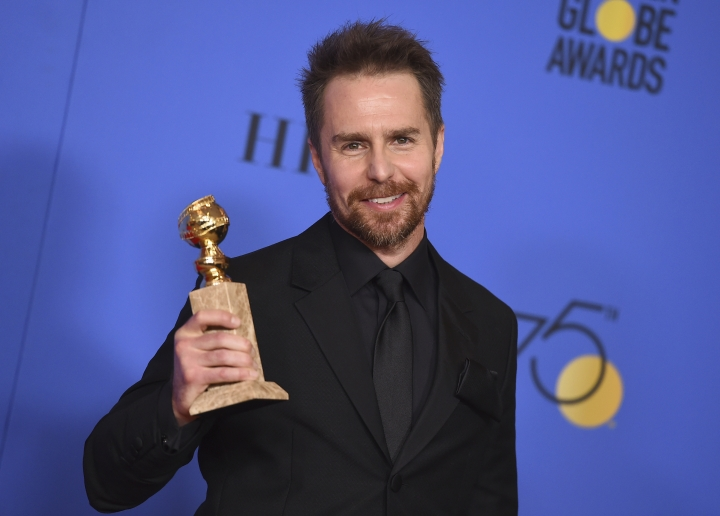 "FILE- In this Jan. 7, 2018, file photo, Sam Rockwell poses in the press room with the award for best performance by an actor in a supporting role in any motion picture for ""Three Billboards Outside Ebbing, Missouri"" at the 75th annual Golden Globe Awards at the Beverly Hilton Hotel in Beverly Hills, Calif. On ""Saturday Night Live,"" guest host Rockwell let an expletive slip during a skit on Saturday, Jan. 13, 2018. He then put his hand to his mouth and said ""sorry"" before continuing with the skit. (Photo by Jordan Strauss/Invision/AP, File)"