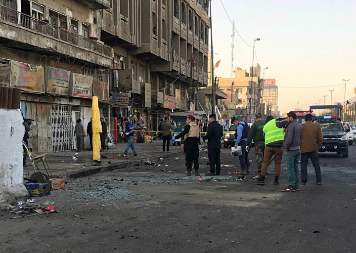 Iraqi security forces gather at the scene of a double suicide bombing in Baghdad, Iraq, Monday, Jan. 15, 2018. Interior Ministry spokesman said a double suicide bombing in central Baghdad has killed and wounded civilians. (AP Photo/Ali Abdul Hassan)