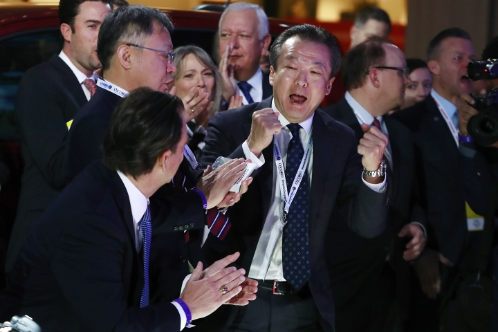 Toshiaki Mikoshiba, center, president and CEO of American Honda Motor Co., reacts after the 2018 Honda Accord won car of the year during the North American International Auto Show, Monday, Jan. 15, 2018, in Detroit. (AP Photo/Carlos Osorio)