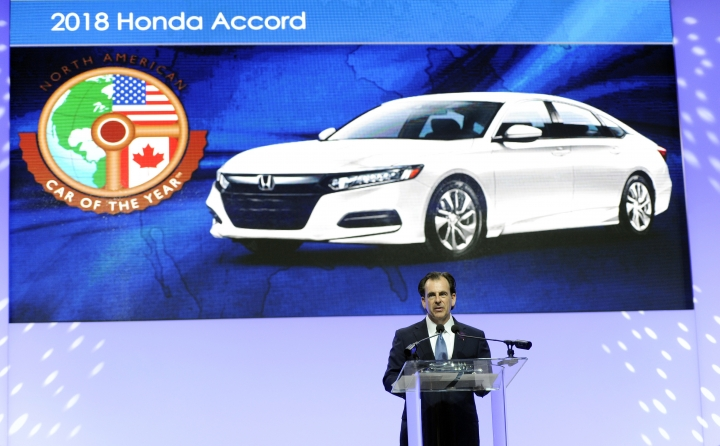 Henio Arcangeli Jr., Sr. Vice President Automobile Division for American Honda Motor Co., Inc, accepts the award for the 2018 Honda Accord's North American Car of the Year award at the North American International Auto Show, Monday, Jan. 15, 2018, in Detroit. (AP Photo/Jose Juarez)