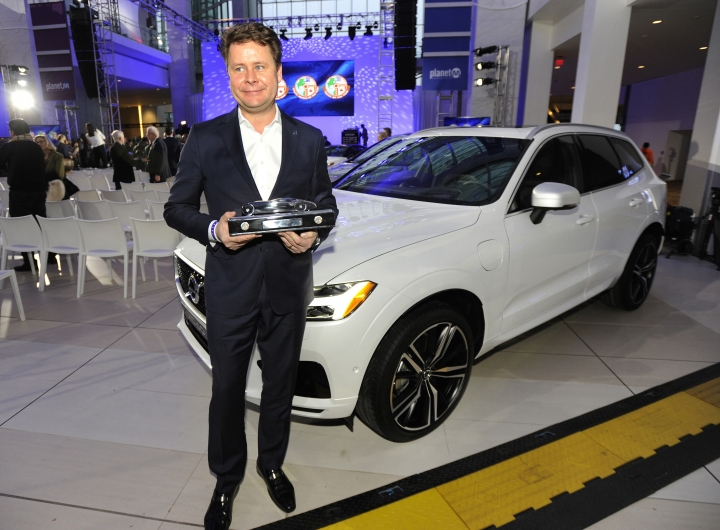 UPDATES TITLE TO SENIOR VICE PRESIDENT AMERICAS - Anders Gustafsson, senior vice president Americas Volvo Car Group, stands in front of the 2018 Volvo XC60 as he shows off the award for the North American Utility Vehicle of the Year at the North American International Auto Show, Monday, Jan. 15, 2018, in Detroit. (AP Photo/Jose Juarez)