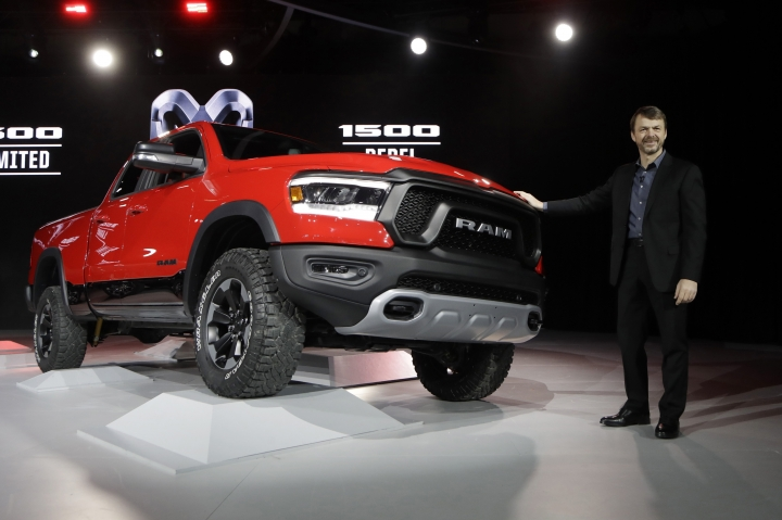 Mike Manley, head of the Ram brand, stands next to the 2019 Ram Rebel during the North American International Auto Show, Monday, Jan. 15, 2018, in Detroit. (AP Photo/Carlos Osorio)