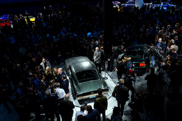 "Celebrating the 50th anniversary of iconic movie ""Bullitt"" and its fan-favorite San Francisco car chase, Ford introduces the new 2019 Mustang Bullitt, center right, next to the original, center left, at the North American International Auto Show, Sunday, Jan. 14, 2018, in Detroit. (Jake May/The Flint Journal-MLive.com via AP)"