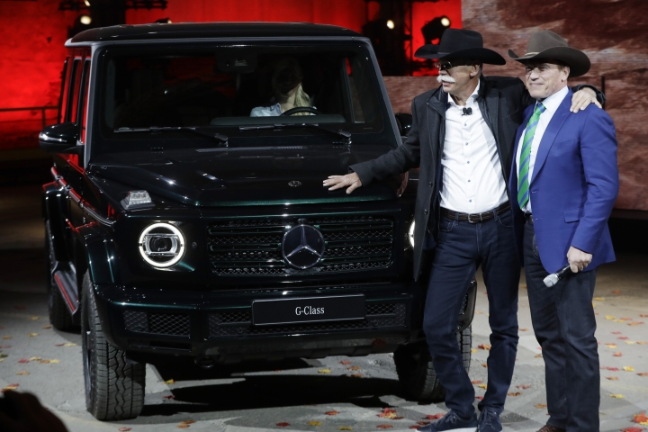 Daimler AG Chairman Dieter Zetsche, stands with former California Gov. Arnold Schwarzenegger, right, after the world premiere of the Mercedes-Benz G-Class during the North American International Auto Show, Sunday, Jan. 14, 2018, in Detroit. (AP Photo/Carlos Osorio)
