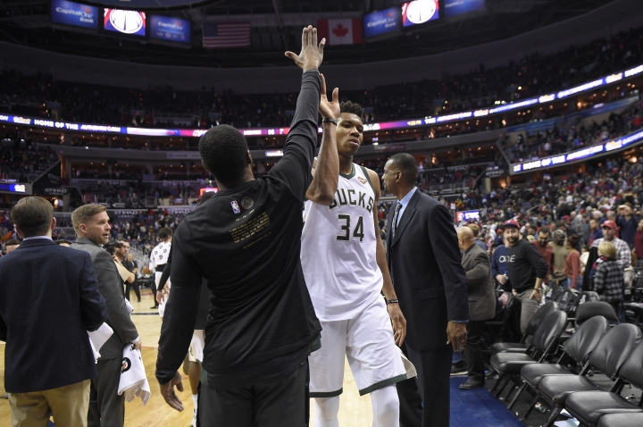 Milwaukee Bucks forward Giannis Antetokounmpo (34), of Greece, gets a high five as he leaves the court after an NBA basketball game against the Washington Wizards, Monday, Jan. 15, 2018, in Washington. The Bucks won 104-95. (AP Photo/Nick Wass)
