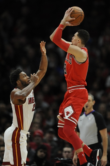 Chicago Bulls' Zach LaVine (8) goes up for a shot against Miami Heat's Justise Winslow (20) during the first half of an NBA basketball game Monday, Jan. 15, 2018, in Chicago. (AP Photo/Paul Beaty)