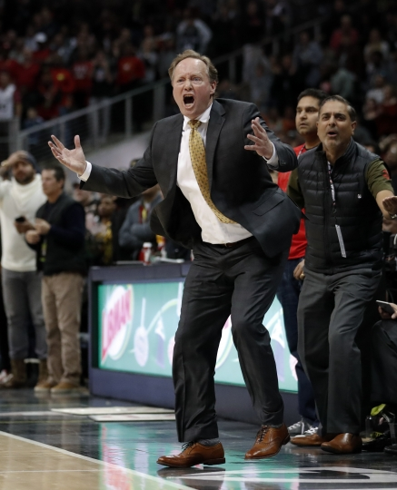 Atlanta Hawks head coach Mike Budenholzer reacts on the sidelines during the second half of an NBA basketball game against the San Antonio Spurs, Monday, Jan. 15, 2018, in Atlanta. The Hawks won 102-99. (AP Photo/John Bazemore)
