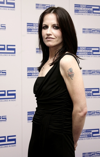FILE - In this April 30, 2004 file photo, singer Dolores O'Riordan poses for photographers at the Sony Radio Academy Awards 2007, in London. Dolores O'Riordan, lead singer of Irish band The Cranberries, has died. She was 46, it was reported Monday, Jan. 15, 2018. (Yui Mok/PA via AP, File)