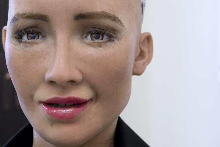 "In this Sept. 28, 2017, photo, Hanson Robotics' flagship robot Sophia, a lifelike robot powered by artificial intelligence, speaks, in Hong Kong. Sophia is a creation of the Hong Kong-based startup working on bringing humanoid robots to the marketplace. Founder David Hanson envisions a future in which AI-powered robots evolve to become ""super-intelligent genius machines"" that can help solve mankind's most challenging problems. (AP Photo/Kin Cheung)"