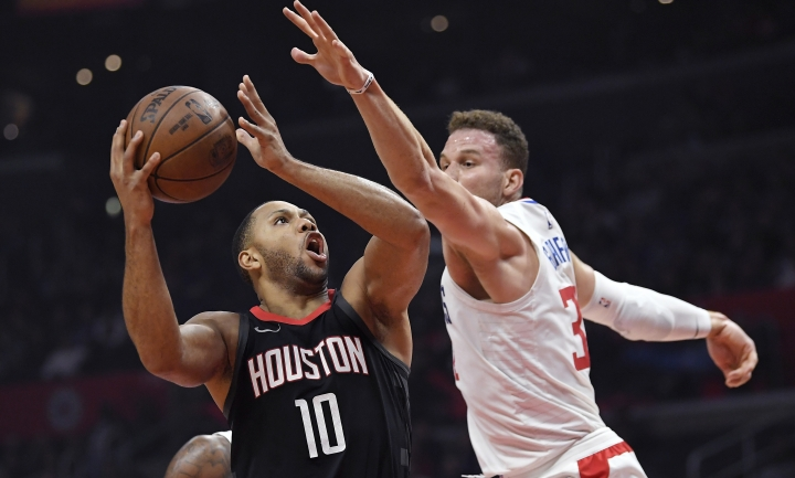Houston Rockets guard Eric Gordon, left, shoots as Los Angeles Clippers forward Blake Griffin defends during the first half of an NBA basketball game, Monday, Jan. 15, 2018, in Los Angeles. (AP Photo/Mark J. Terrill)