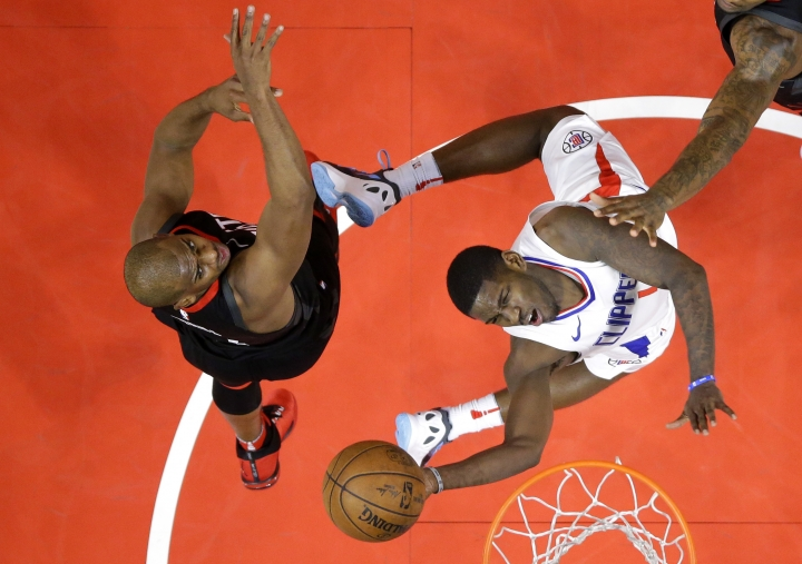 Los Angeles Clippers guard Jawun Evans, right, shoots as Houston Rockets guard Chris Paul defends during the first half of an NBA basketball game, Monday, Jan. 15, 2018, in Los Angeles. (AP Photo/Mark J. Terrill)