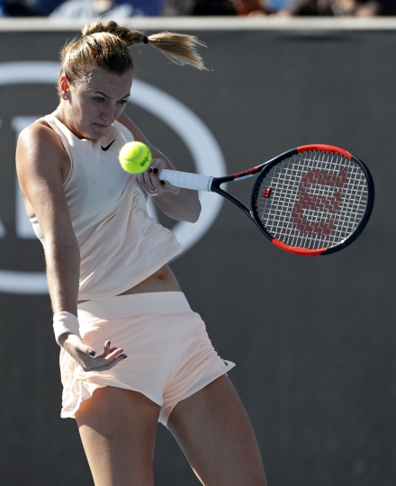 Petra Kvitova of the Czech Republic looks to make a return to Germany's Andrea Petkovic during their first round match at the Australian Open tennis championships in Melbourne, Australia, Tuesday, Jan. 16, 2018. (AP Photo/Ng Han Guan)