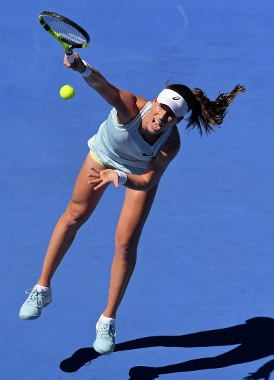 Britain's Johanna Konta serves to United States' Madison Brengle during their first round match at the Australian Open tennis championships in Melbourne, Australia, Tuesday, Jan. 16, 2018. (AP Photo/Andy Brownbill)