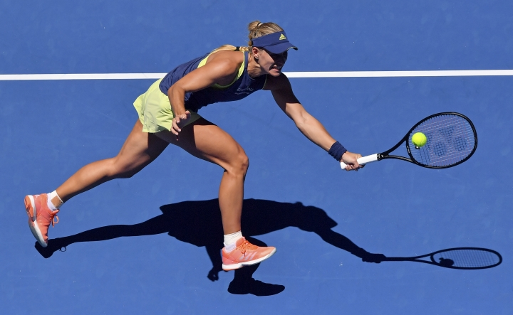 Germany's Angelique Kerber reaches for a return to compatriot Anna-Lena Friedsam during their first round match at the Australian Open tennis championships in Melbourne, Australia, Tuesday, Jan. 16, 2018. (AP Photo/Andy Brownbill)