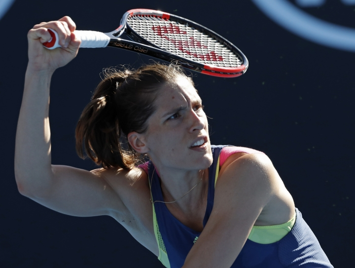 Germany's Andrea Petkovic follows through on a shot to Petra Kvitova of the Czech Republic during their first round match at the Australian Open tennis championships in Melbourne, Australia, Tuesday, Jan. 16, 2018. (AP Photo/Ng Han Guan)