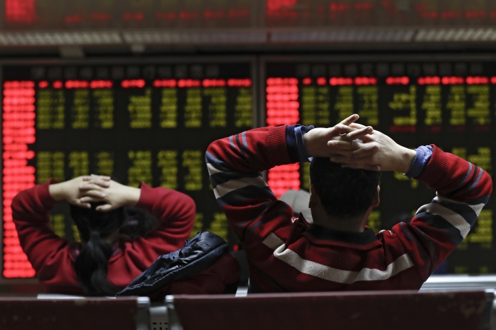 Investors monitor stock prices at a brokerage house in Beijing, Tuesday, Jan. 16, 2018. Asian stock markets have risen following a holiday for U.S. markets as investors look ahead to American corporate earnings reports. (AP Photo/Andy Wong)