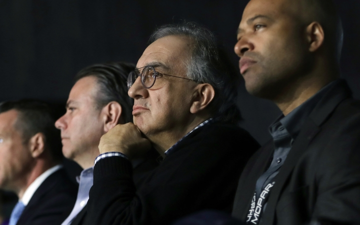 Fiat Chrysler Automobiles CEO Sergio Marchionne, center, watches the unveiling of the new 2019 Jeep Cherokee during the North American International Auto Show, Tuesday, Jan. 16, 2018, in Detroit. (AP Photo/Carlos Osorio)